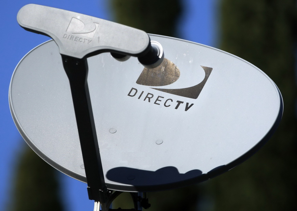Earns DirecTV Group